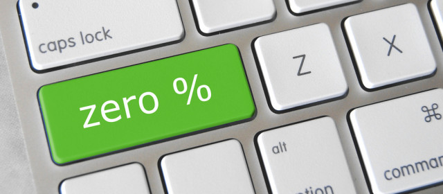 Zero percent key on a keyboard depicting a no interest credit card offer.