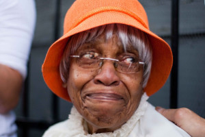 A senior african american woman gets help with money management.