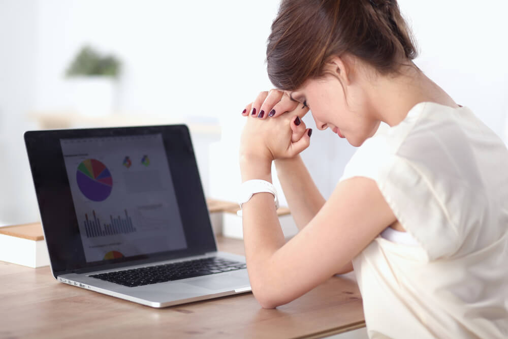 young woman frustrated with debt solutions